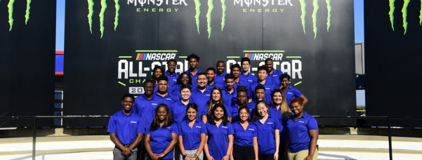 Interns pose at a NASCAR event